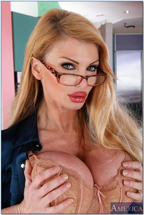 Lusty mature teacher Taylor Wane revealing superb juggs and ass