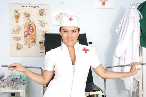 Petite vixen in nurse uniform stripping and spreading her legs